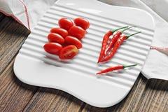 Πιπέρι ντοματών και τσίλι κερασιών, κόκκινα τρόφιμα, Phytonutrient Στοκ εικόνα με δικαίωμα ελεύθερης χρήσης