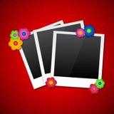 Πλαίσια φωτογραφιών με τα χρωματισμένα λουλούδια Στοκ Εικόνες