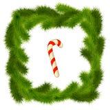 Πλαίσιο φιαγμένο από χριστουγεννιάτικο δέντρο με μια καραμέλα Στοκ Εικόνα