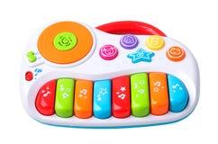Πλαστικό αντικείμενο παιχνιδιών πιάνων που απομονώνεται στοκ φωτογραφίες