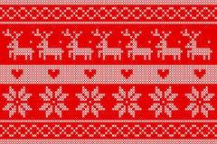 Πλεκτά Χριστούγεννα στο κόκκινο σχέδιο υποβάθρου στοκ φωτογραφία με δικαίωμα ελεύθερης χρήσης
