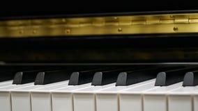 Πληκτρολόγιο πιάνων με τον πυροβολισμό κινηματογραφήσεων σε πρώτο πλάνο Στοκ Εικόνες
