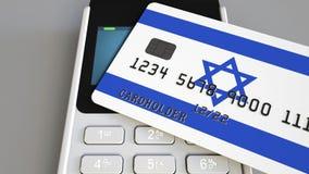 Πληρωμή ή POS τερματικό με την πιστωτική κάρτα που χαρακτηρίζει τη σημαία του Ισραήλ Ισραηλινό λιανικό εμπόριο ή τραπεζικό σύστημ απόθεμα βίντεο