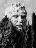 Πνεύμα του δασικού ατόμου με το δέρμα δράκων και το γενειοφόρο πρόσωπο Στοκ Εικόνες