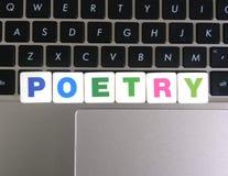 Ποίηση λέξης στο υπόβαθρο πληκτρολογίων Στοκ Φωτογραφίες