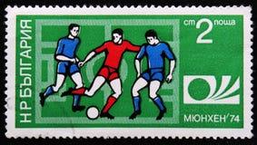 ποδοσφαιριστές, ένα Μόναχο 74 έμβλημα Παγκόσμιου Κυπέλλου ποδοσφαίρου, circa 1974 Στοκ Εικόνα