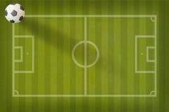 Ποδόσφαιρο ποδοσφαίρου Plasticine στο πεδίο εγγράφου στοκ φωτογραφία με δικαίωμα ελεύθερης χρήσης