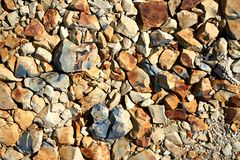 Πολλά από το κίτρινο, γραπτό υπόβαθρο πετρών Στοκ Φωτογραφίες