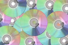 Πολλοί καλύπτουν το CD, δίσκος DVD στο υπόβαθρο Στοκ Φωτογραφίες