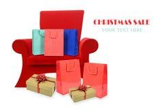Πολυθρόνα Άγιου Βασίλη με τα δώρα στοκ εικόνες
