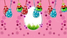 Πολύχρωμα αυγά Πάσχας που κρεμούν σε ένα ρόδινο υπόβαθρο φιλμ μικρού μήκους