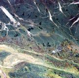 Πολύχρωμη επιφάνεια της μαρμάρινης κινηματογράφησης σε πρώτο πλάνο σύστασης φυσική πέτρα ανασκόπησης Στοκ Εικόνες