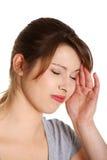 πονοκέφαλος που υφίσταται τις γυναίκες στοκ εικόνες