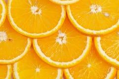 πορτοκάλια ανασκόπησης που τεμαχίζονται Στοκ Φωτογραφίες