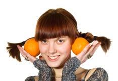πορτοκάλια κοριτσιών δύο Στοκ Εικόνες