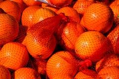 Πορτοκάλια σε μια καθαρή τσάντα Στοκ Φωτογραφίες