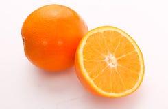 Πορτοκάλι - μισό πορτοκάλι Στοκ Εικόνα