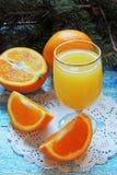 Πορτοκαλής και χυμός από πορτοκάλι νέο έτος ανασκόπησης Στοκ Φωτογραφία