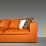 πορτοκαλής καναπές Στοκ Εικόνα