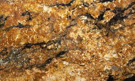 Πορτοκαλής στενός επάνω βράχου γρανίτη στοκ φωτογραφίες