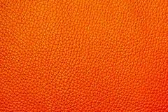 Πορτοκαλί χρώμα με τη λεπτή ταπετσαρία υποβάθρου σύστασης Στοκ Φωτογραφίες