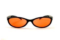 πορτοκαλιά γυαλιά ηλίο&upsil Στοκ Φωτογραφίες