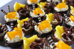 Πορτοκαλιά καλάθια σοκολάτας κρέμας Στοκ εικόνα με δικαίωμα ελεύθερης χρήσης