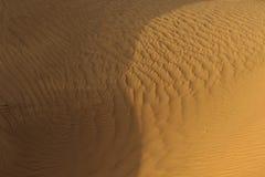 Πορτοκαλιά κινηματογράφηση σε πρώτο πλάνο σύστασης άμμου στοκ εικόνες