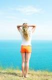 πορτοκαλιά σορτς κοριτσιών Στοκ φωτογραφίες με δικαίωμα ελεύθερης χρήσης