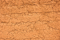 Πορτοκαλής τοίχος σύστασης λάσπης Στοκ Εικόνα