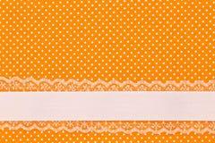 Πορτοκαλί αναδρομικό κλωστοϋφαντουργικό προϊόν σημείων Πόλκα Στοκ φωτογραφία με δικαίωμα ελεύθερης χρήσης