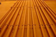 Πορτοκαλί βιομηχανικό υπόβαθρο σωληνώσεων Στοκ Εικόνες