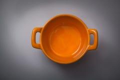 Πορτοκαλί μαγειρεύοντας δοχείο Στοκ Εικόνες