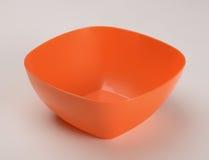 Πορτοκαλί πλαστικό βαθύ πιάτο Στοκ εικόνα με δικαίωμα ελεύθερης χρήσης