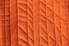 Πορτοκαλί στενό επάνω υπόβαθρο υφάσματος - γραφικό σχέδιο Στοκ Εικόνες