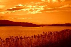 Πορτοκαλί τοπίο ηλιοβασιλέματος λιμνών της Βάρνας Στοκ φωτογραφία με δικαίωμα ελεύθερης χρήσης