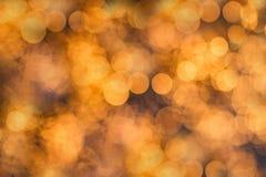 Πορτοκαλί υπόβαθρο φω'των bokeh Στοκ Φωτογραφία
