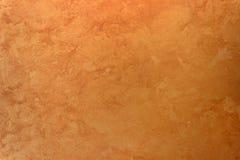Πορτοκαλί χρυσό υπόβαθρο χρωμάτων επίδρασης μεταξιού σύστασης τοίχων Στοκ Εικόνα