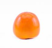 Πορτοκαλί persimmon σε ένα άσπρο υπόβαθρο - μπροστινή άποψη Στοκ Εικόνα