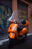 Πορτοκαλί Piaggio Vespa Στοκ Εικόνες