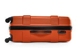 Πορτοκαλιά βαλίτσα χρώματος Να βρεθεί οριζόντια Στοκ Φωτογραφίες