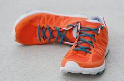 πορτοκαλιά παπούτσια Στοκ Εικόνες