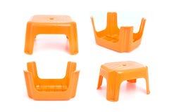 Πορτοκαλιά παραδοσιακή μίνι πλαστική καρέκλα τεσσάρων ποδιών στο μόριο Στοκ Φωτογραφίες