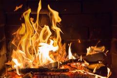 Πορτοκαλιά πυρκαγιά στην εστία στοκ φωτογραφία με δικαίωμα ελεύθερης χρήσης