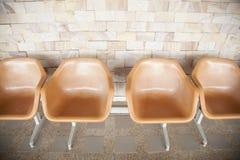 Πορτοκαλιά πλαστική καρέκλα Στοκ Φωτογραφίες