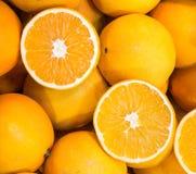 Πορτοκαλιά ώριμα juicy πορτοκάλια υποβάθρου για την πώληση Στοκ Φωτογραφίες
