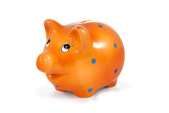 Πορτοκαλιά piggy τράπεζα που απομονώνεται στο λευκό Στοκ Εικόνες
