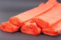 Πορτοκαλιές πλαστικές τσάντες στοκ φωτογραφία