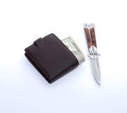 πορτοφόλι χρημάτων μαχαιρι στοκ εικόνα