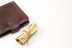 Πορτοφόλι και ένας ρόλος των χρημάτων Στοκ φωτογραφίες με δικαίωμα ελεύθερης χρήσης